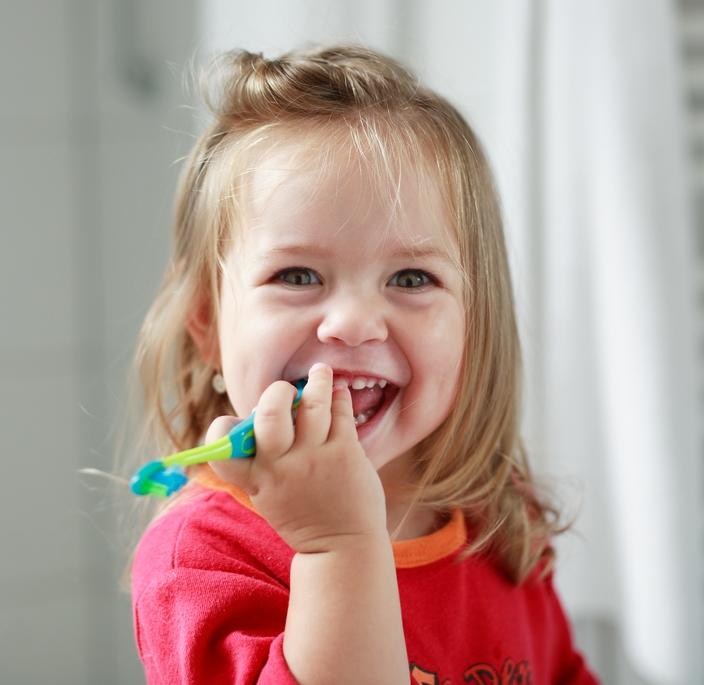 girl brushing teeth-1