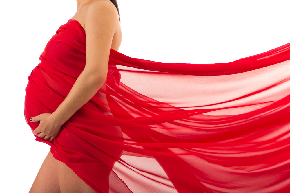 pregnant woman in red_92829262